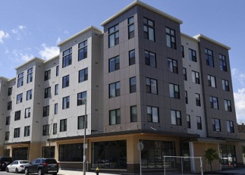 Nuestra Communidad, Roxbury MA, developers of the Bartlett Station, featuring both affordable and market-rate rental and homeownership housing, with a public events plaza, grocery store, shops, and interactive art area.